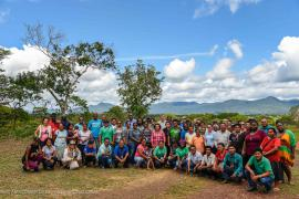 Group photo of all the participants to the workshop and the inhabitants of Nappi with the Kanuku Mountains in the backdrop © Claudia Berthier PAG