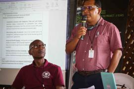 14.David James, legal advisor at the Ministry of Indigenous Affairs of Guyana, and Helmut Gezius, Direction Coordinator of the Sociology Course at Anton de Kom University of Suriname, during the panel discussion on community involvement and Access and Benefit Sharing in Protected Areas Management  © Arnaud Anselin PAG